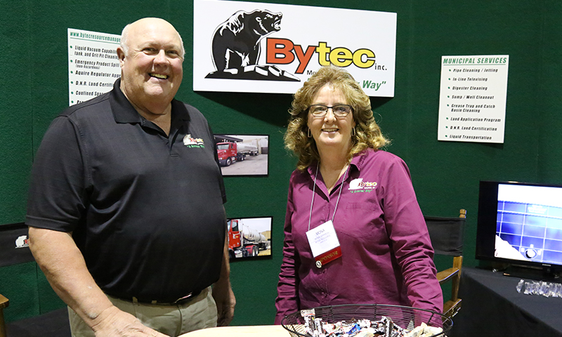Steve and Mona with trade show booth.